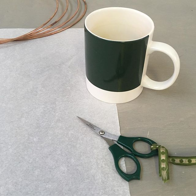 Going green! Matching tools of the trade on the workbench today, trusty snips & Christmas mug from the NP team #pantone3435 #naomipaullighting #green #alpine #colour #studio #januarytones